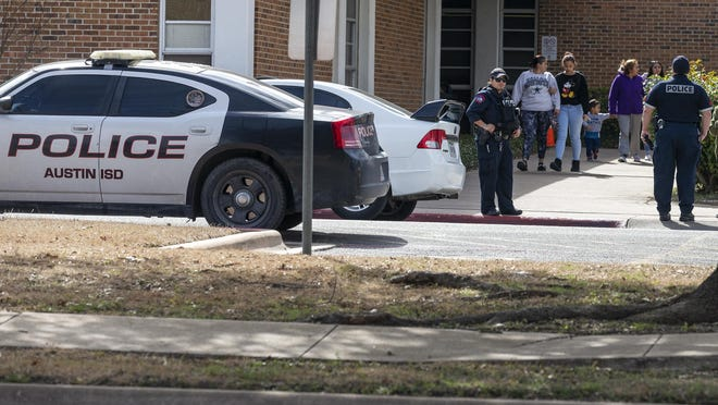 Austin Independent School District police monitor as students exit Lanier High School in North Austin after a lockdown Jan. 30, 2019. Austin police later found a 15-year-old with an airsoft gun south of the school.