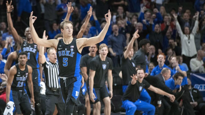 Duke's Luke Kennard signals he made a 3-pointer, which is something he did on 43.8 percent of his attempts.