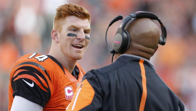 Andy Dalton, talking with offensive coordinator Hue Jackson, threw for 321 passing yards and had a Quarterback Rating of 127.1 Sunday.