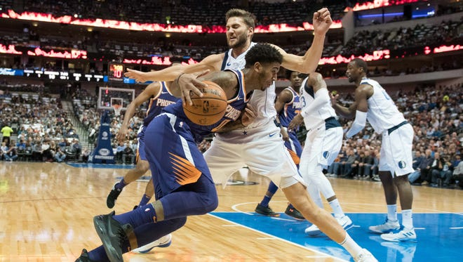 Phoenix Suns forward Marquese Chriss (0) drives to the basket past Dallas Mavericks forward Maximilian Kleber (42) during the first quarter at American Airlines Center.