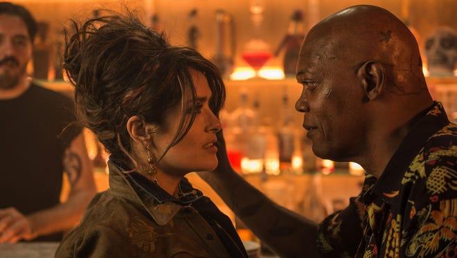 "Salma Hayek and Samuel L. Jackson star in ""The Hitman's Bodyguard."""