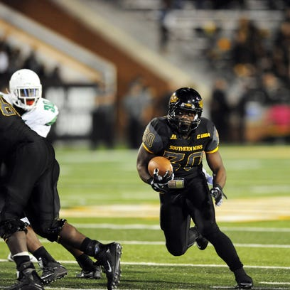 Southern Miss player Jalen Richard (30) runs the ball against North Texas at M.M. Roberts Stadium Saturday.