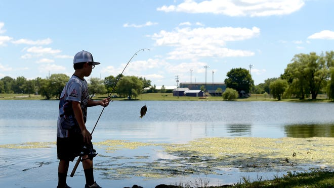 Fishing at Eldridge Park in Elmira on June 29, 2018.