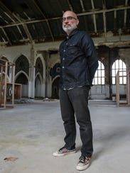 Al Moran, a gallerist from Los Angeles, stands in the