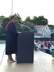 Poughkeepsie High School Executive Principal Phee Simpson speaks to students at the June 2016 commencement ceremony.