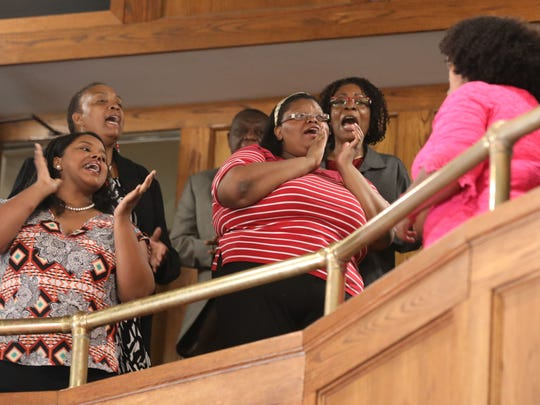 The choir sing during the Sunday service at St. Charles
