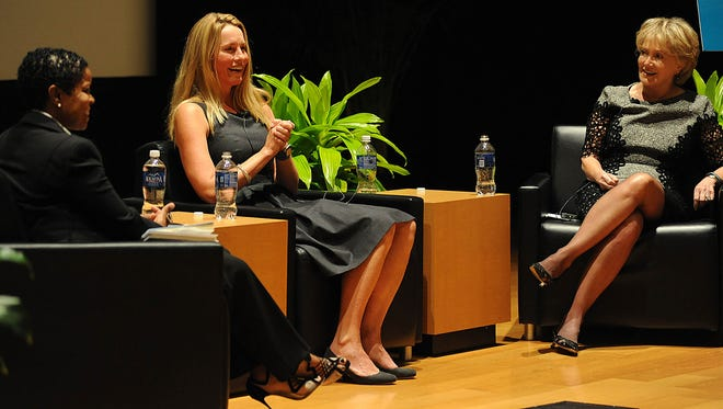 Toni Cooley, from left, CEO of Madison-based Systems Electro Coating LLC,  Laurene Powell Jobs, president of Emerson Collective and widow of Apple's Steve Jobs, and Donna Barksdale, philanthropist and community leader, discuss education issues during the Women's Foundation of Mississippi's annual Meeting  at the Jackson Convention Complex Thursday in Jackson.