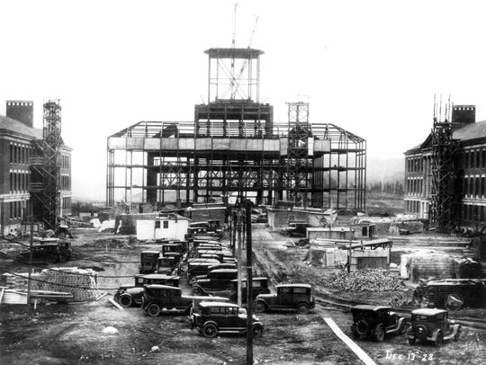 Building the Rush Rhees library in 1928; George W.