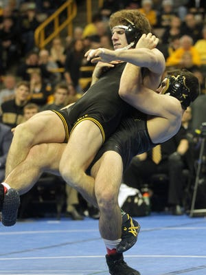 """Missouri's Willie Miklus met Iowa's Alex Meyer at 184 pounds and won 6-5. Both graduated from Southeast Polk in 2012. """"He was my drill partner, senior year, every day. Countless hours,"""" Miklus said."""