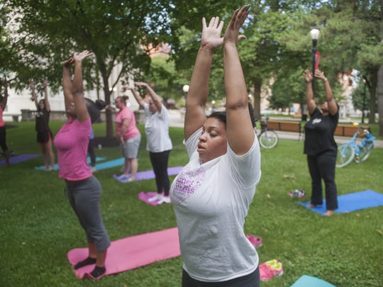 Women do yoga in a South Jersey park. Self care is important for parents who need to remain strong and resilient for the the challenges of parenting.