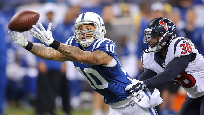 Indianapolis Colts wide receiver Donte Moncrief, shown here against the Texans last week, will start in place of T.Y. Hilton vs. Dallas.