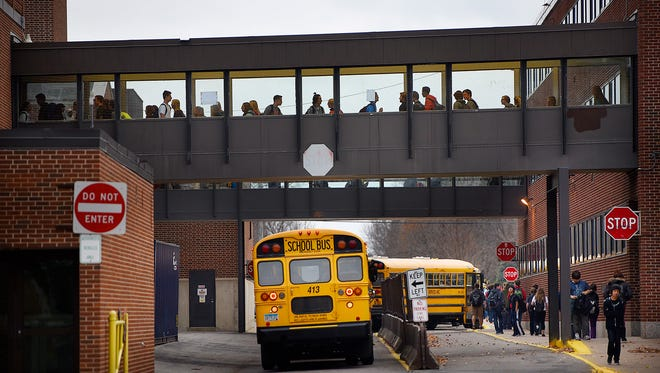 Students move between buildings at the end of the school day Thursday at Tech High School in St. Cloud. After last week's failed referendum vote, school board members and administration officials are deciding what the next step will be.