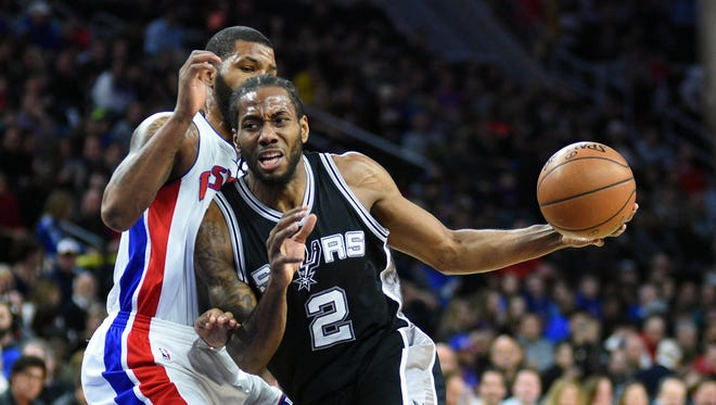 Spurs forward Kawhi Leonard drives to the basket during the first quarter as Pistons forward Marcus Morris defends during the Pistons' 103-92 loss Friday, Feb. 10, 2017 at the Palace.