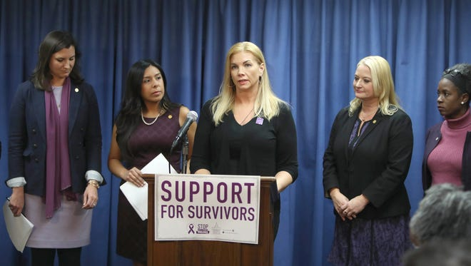Nicole Beverly,  a domestic violence survivor,  speaks during a press conference held by the Michigan Progressive Women's Caucus' Gender Violence Task Force to introduce a package of bills meant to address gaps in state law to better support survivors of gender and domestic violence on Thursday, November 9, 2017 in Lansing.