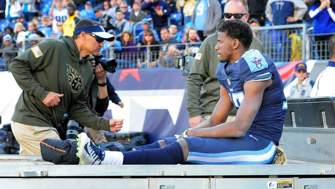Titans wide receiver Justin Hunter is carted off the field after fracturing his ankle in the fourth quarter against the Panthers.