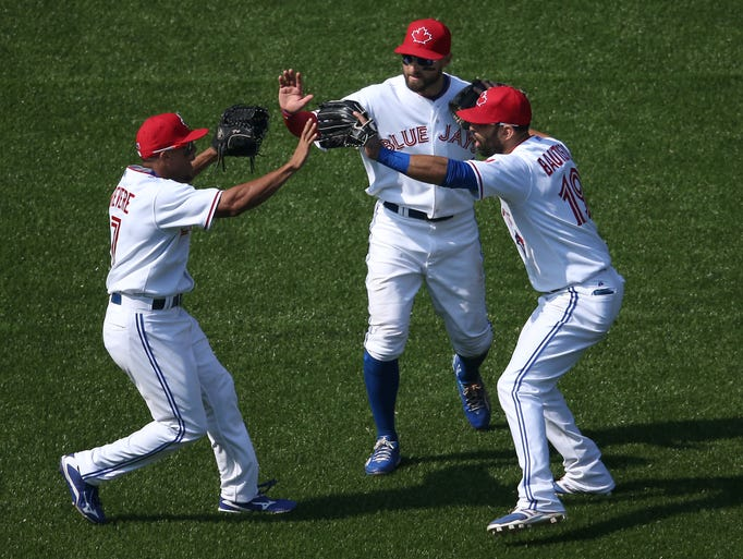 Ben Revere (7) of the Toronto Blue Jays celebrates