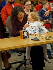Deanna Pedicone, a Delaware Department of Health and Social Services worker, hold her 4 -year-old daughter Zoe during her official adoption at the New Castle County Courthouse on Friday.