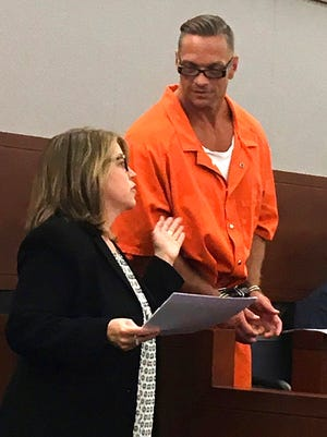 Nevada death row inmate Scott Raymond Dozier confers with Lori Teicher, a federal public defender involved in his case, during a Thursday, Aug. 17, 2017 appearance in Clark County District Court in Las Vegas.