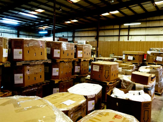 Crates of supplies are seen ready for shipping at God's