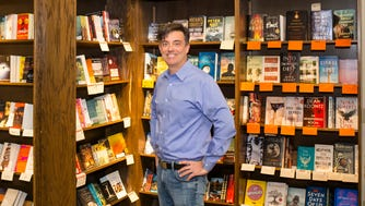 "Novelist Liam Callanan stands in Boswell Books, which gets a sly shoutout in his new novel ""Paris by the Book."""