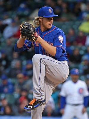 Pitcher Noah Syndergaard of the Mets made his Major League debut against the Chicago Cubs last night.