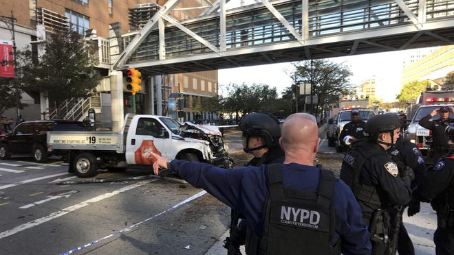 New York City Police Officers respond to a report of gunfire along West Street near the pedestrian bridge at Stuyvesant High School in lower Manhattan in New York, Tuesday, Oct. 31, 2017.