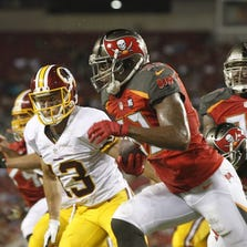 Buccaneers linebacker Nate Askew (53) runs with the ball after intercepting the ball in the end zone against the Washington Redskins during the first half at Raymond James Stadium.