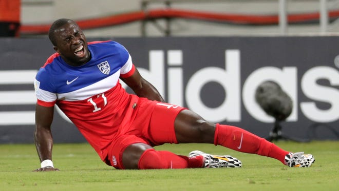 United States' Jozy Altidore grimaces after pulling up injured during the group G World Cup soccer match between Ghana and the United States at the Arena das Dunas in Natal, Brazil, June 16, 2014.