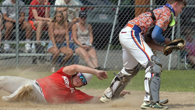 Northboro's Jeff Lamothe scores the tying run in the fourth inning on a wild pitch, as Leominster catcher Ryan Kolakowski is unable to make the tag, during the Worcester County Baseball League Championship game played at McLaughlin Park on Sunday, Aug. 9.