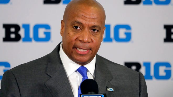 FILE - In this June 4, 2019, file photo,  Minnesota Vikings chief operating officer Kevin Warren talks to reporters after being named Big Ten Conference Commissioner during a news conference in Rosemont, Ill. After the Power Five conference commissioners met Sunday, Aug. 9, 2020, to discuss mounting concern about whether a college football season can be played in a pandemic, players took to social media to urge leaders to let them play.