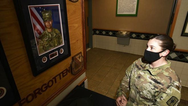 Staff Sgt. Cassandra Rodeheaver, a drill sergeant assigned to Company B, 787th Military Police Battalion, played a pivotal role in adding Pvt. Eric Stinson -- a trainee assigned to Bravo Company who passed away from cancer in 2019 -- to the battalion's memorial wall. Stinson's portrait was hung during a ceremony on Veterans Day at the 787th MP Bn. headquarters building. Photo by Brian Hill