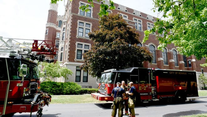 City of Monroe Fire Department (above) responded to a first floor fire Thursday at Norman Towers in Monroe as residents were evacuated.