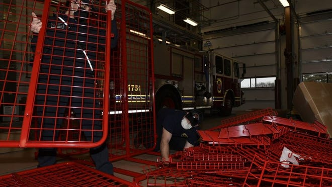 Firefighters Frank Boniello (left) and Malcolm Smith construct lockers for fire-fighting equipment Jan. 14 at Fort Leonard Wood's new Fire Station No. 3. The station is set to open Jan. 22 and will provide quicker response times to locations on the east side of the cantonment area.