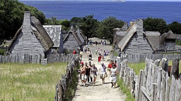 Visitors walk around in a 1627 Pilgrim Village at Plimoth Plantation in Plymouth. The living history museum announced on Facebook this week it is changing its name to Plimoth Patuxet in recognition of Indigenous people and as part of the 400th anniversary of the Pilgrims' arrival there.