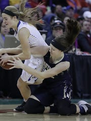 Howards Grove High School's Ashley Reinemann, left, battles for a loose ball against Aquinas High School's Kayla Bahr during their WIAA Division 4 State Tournament final girls basketball game Friday, March 10, 2017, at the Resch Center in Ashwaubenon, Wis. Dan Powers/USA TODAY NETWORK-Wisconsin