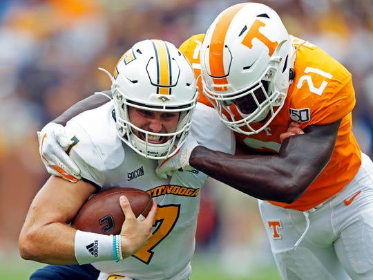 Chattanooga quarterback Nick Tiano (7) is tackled by Tennessee linebacker Shanon Reid (21) in the second half of an NCAA college football game Saturday, Sept. 14, 2019, in Knoxville, Tenn. Tennessee won 45-0. (AP Photo/Wade Payne)