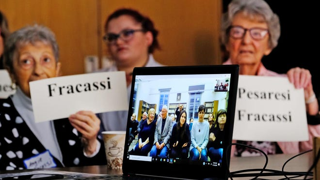 """In this Dec. 18, 2019, photo, Angie Fracassi, left, and Dorothy Pesaresi, gather at Portsmouth City Hall Wednesday to Skype with their Italian counterparts and toast to a new """"Friendship City"""" agreement with Santarcangelo di Romagna, Italy."""