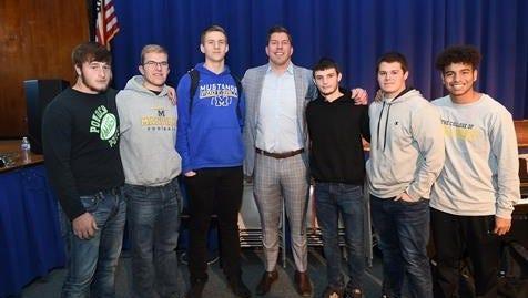 David Diehl with members of the Manville High School football team.