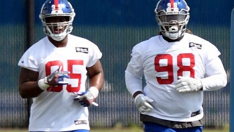 New York Giants defensive linemen B.J. Hill (95), Damon Harrison (98) and Dalvin Tomlinson (not pictured) have the makings of a strong front as Big Blue switches to a base 3-4 scheme on defense.