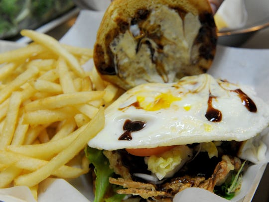 Prawn & Basil's Soft-Shell Crab Burger includes tempura-battered