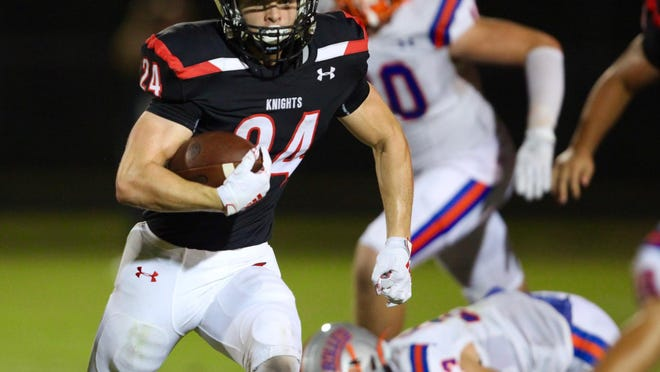 Creekside running back Preston Strope picks up yards in the second quarter of a Sept. 20, 2019, contest against Bolles. He is one of 16 returning starters for the Knights.