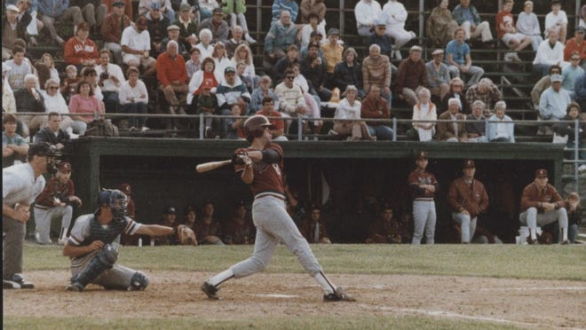 Cotuit Kettleers bat as the crowd looks on at Lowell Park in 1990 Cape Cod Baseball League action.