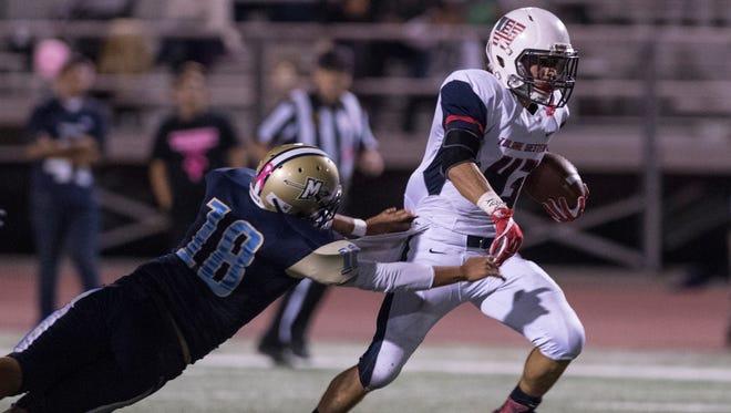 Tulare Western's David Alcantar runs for a touchdown against Monache in an East Yosemite League high school football game on Thursday, Oct. 26, 2017.