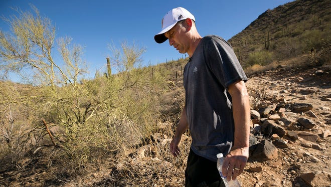 ASU head basketball coach Bobby Hurley hikes in the McDowell Mountains in Scottsdale on July 3, 2018. Since moving to the Valley when Hurley became ASU head basketball coach in 2015, hiking in the desert has become a regular part of his exercise routine.
