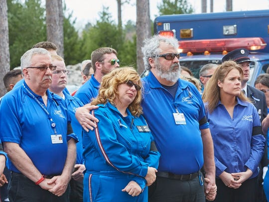 Crew members from Ascension Wisconsin Spirit Medical Transportation pay tribute to their lost colleagues at a memorial service in Woodruff, Friday, May 4.