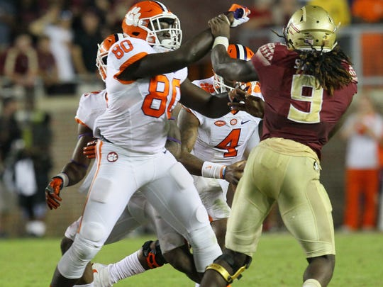 Clemson tight end Milan Richard (80) blocks Florida State defensive end Josh Sweat (9) on a two-point conversion play during the fourth quarter on Saturday October 29 at Doak Campbell Stadium in Tallahassee, Florida.