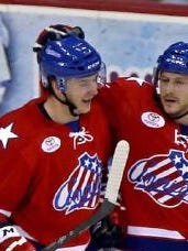 Mark Pysyk, left, is trying to secure an NHL spot by playing well for the Rochester Americans.