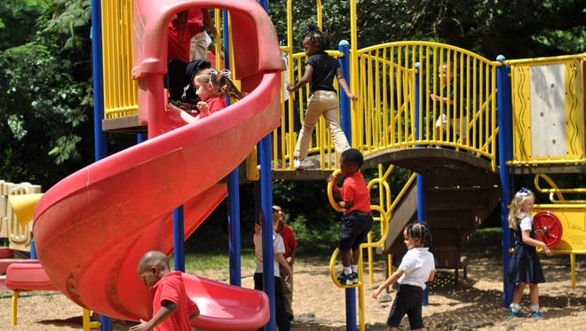Kindergartners at Cherokee Elementary School during recess.