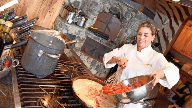 Chef Cat Cora prepares entrees during the Sundance Film Festival in Park City, Utah.