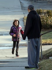 Makayla Zavrl, 9, runs to her dad Zack near her home Tuesday March 8, 2016 in Sheboygan.  Zavrl was bullied and her family took steps to help stop the problems.